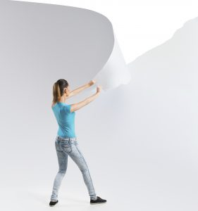 Woman tearing a white paper background